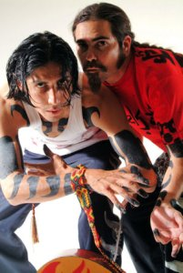 Mezklah hand-paint tribal illustrations all over the duo's bodies before every show
